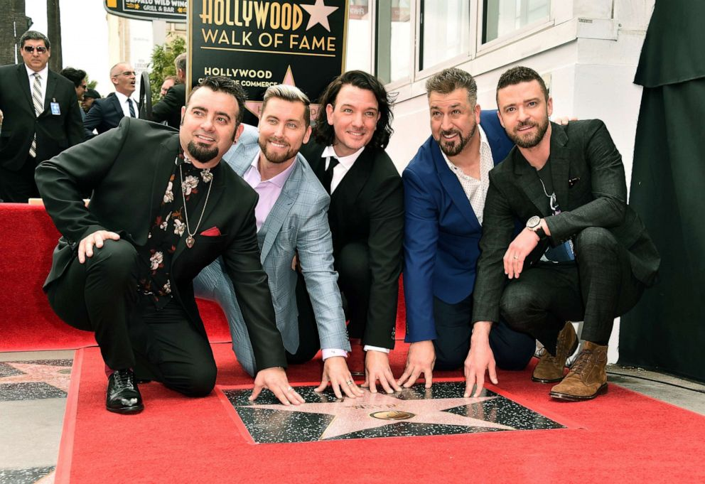 PHOTO: Singers Chris Kirkpatrick, Lance Bass, JC Chasez, Joey Fatone and Justin Timberlake of NSYNC are honored with a star on the Hollywood Walk of Fame, April 30, 2018, in Hollywood, Calif.