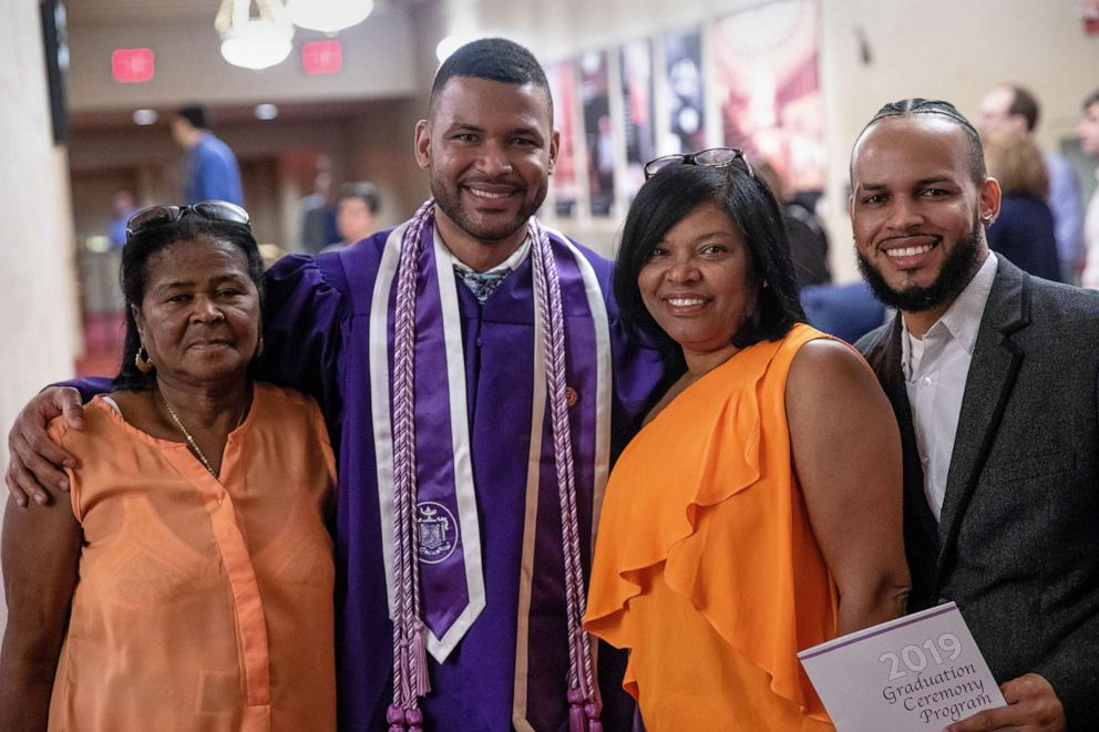 PHOTO: Frank Baez poses with his family after graduating from NYU Rory Meyers College of Nursing, May 20, 2019.