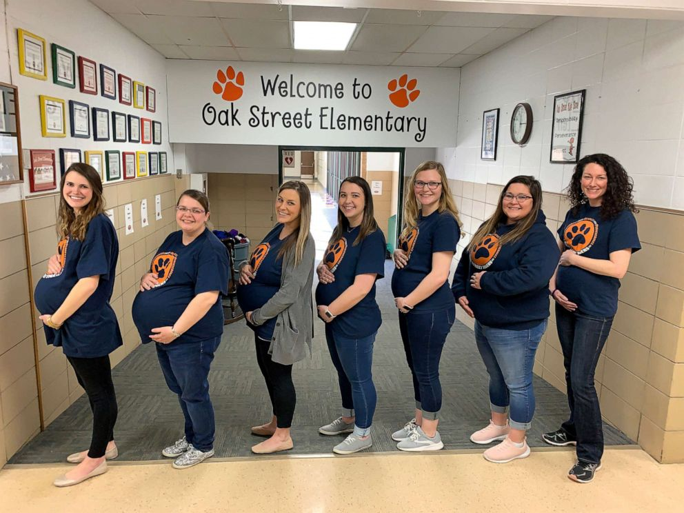 PHOTO: The seven pregnant teachers pose in their due date order in the front hall at Oak Street Elementary in Goddard, Kan.