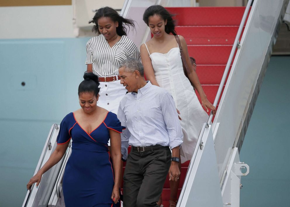 PHOTO: President Barack Obama, first lady Michelle Obama, and their daughters, Sasha, top left, and Malia, step off Air Force One at Joint Base Cape Cod for a vacation, Aug. 6, 2016.