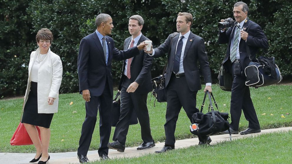 In this file photo, President Barack Obama (2nd L) is joined by (L-R) advisor Valerie Jarrett, Principal Deputy Press Secretary Eric Schultz, personal aide Joe Paulsen and photographer Pete Souza as they depart the White House, Oct. 7, 2016, in Washington, DC.