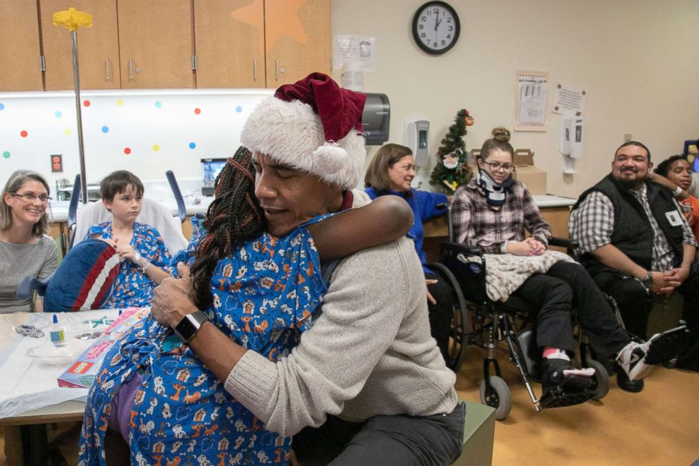 PHOTO: Former President Barack Obama visited children and families at the Childrens National hospital in Washington, D.C., Dec. 19, 2018, to drop off some Christmas gifts.