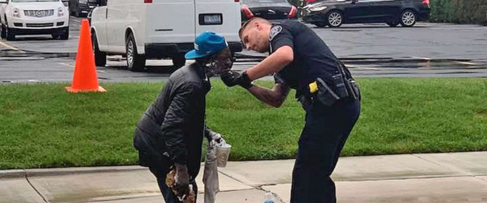 PHOTO: Officer Jeremy Thomas of the Detroit Police Department, assists Stanley Nelson, 62, with shaving his face in Detroit, in a photo shared by Jill Metiva Schafer on social media, Sept. 11, 2019.