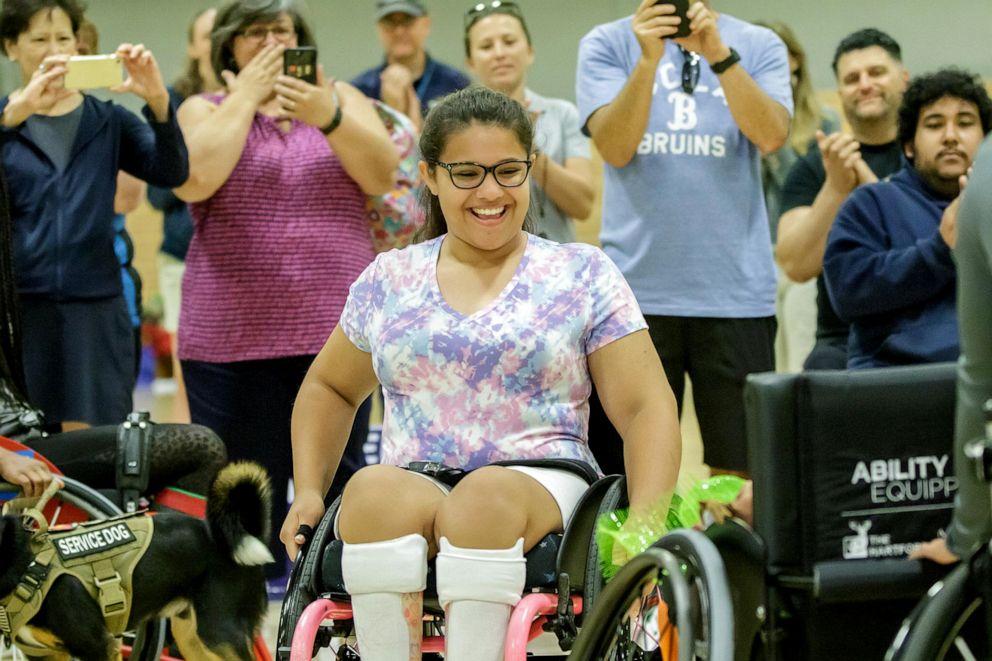 PHOTO: Olivia Curcuru presented with custom wheelchair at Angel City Games, 2019.