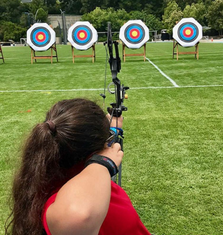 PHOTO: Olivia Curcuru competes at archery during the Angel City Games in Arizona, in June 2019.
