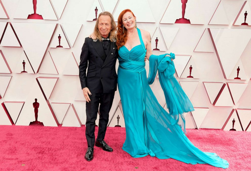 PHOTO: Paul Raci and Liz Hanley Raci attend the 93rd Annual Academy Awards, April 25, 2021, in Los Angeles.