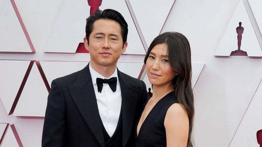 PHOTO: Steven Yeun and Joana Pak attend the 93rd Annual Academy Awards, April 25, 2021, in Los Angeles.