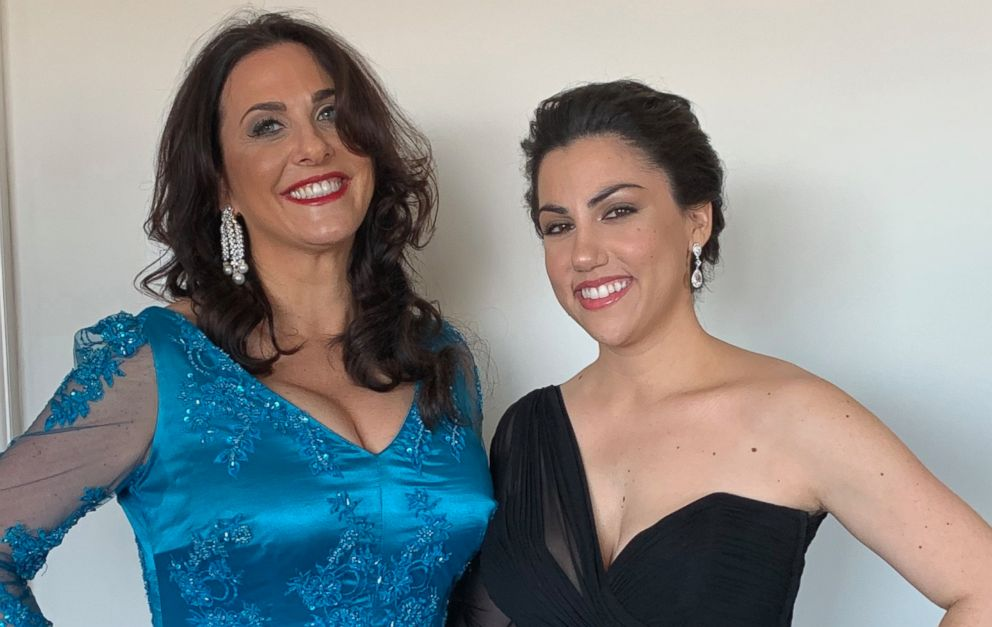 "Los Angeles teacher Melissa Berton and her daughter and ""Period. End of Sentence"" executive producer Helen Yenser pose before departing for the Oscars."