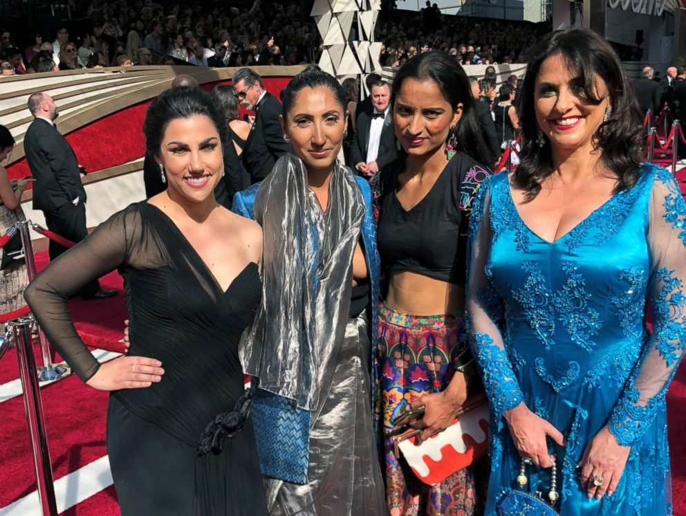 "The ""Period. End of Sentence"" team poses on the red carpet at the 91st annual Academy Awards."