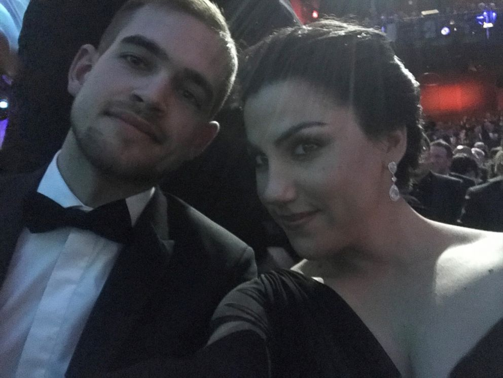 Rayka Zehtabchi and Sam Davis pose for a selfie inside the Dolby Theatre.