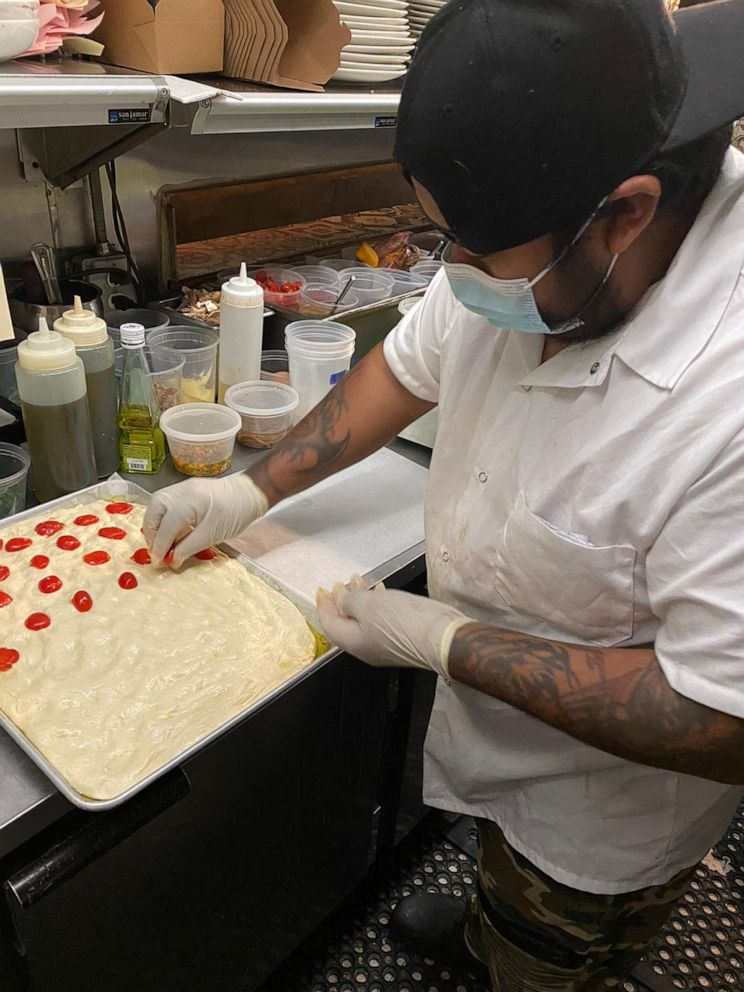 PHOTO: The staff at Osteria 57 makes preparations for their holiday meal service.