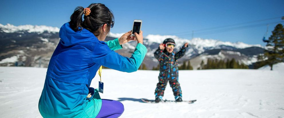 PHOTO: A woman takes a photo of a child in an undated stock photo.