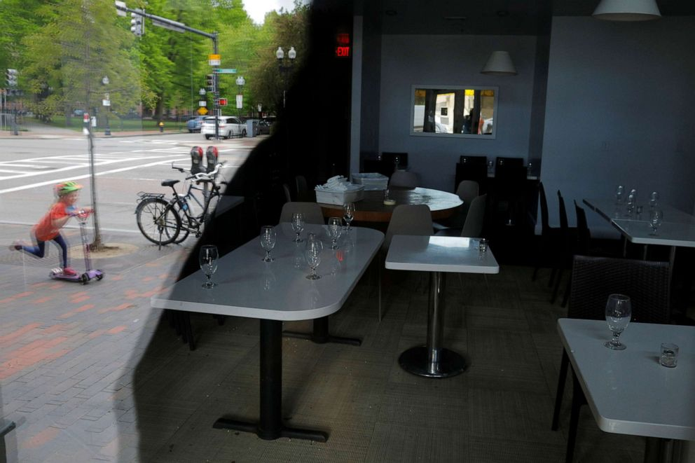 PHOTO: Tables with glassware on them are seen in Stella Restaurant, which announced it is closing permanently, amid the coronavirus disease outbreak in Boston, May 18, 2020.