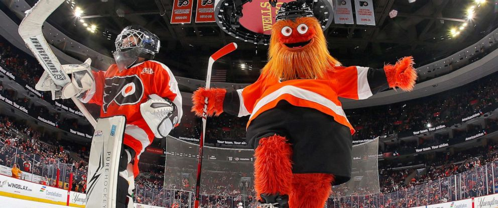 PHOTO: In this file photo, Gritty, the mascot of the Philadelphia Flyers entertains the crowd during the first period intermission with a member of the Mites on Ice against the Nashville Predators on December 20, 2018 in Philadelphia.