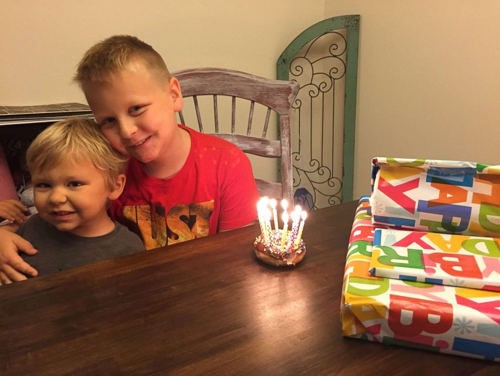 Avett Maness, 6, is seen in an undated photo with his older brother, Emery Moore.