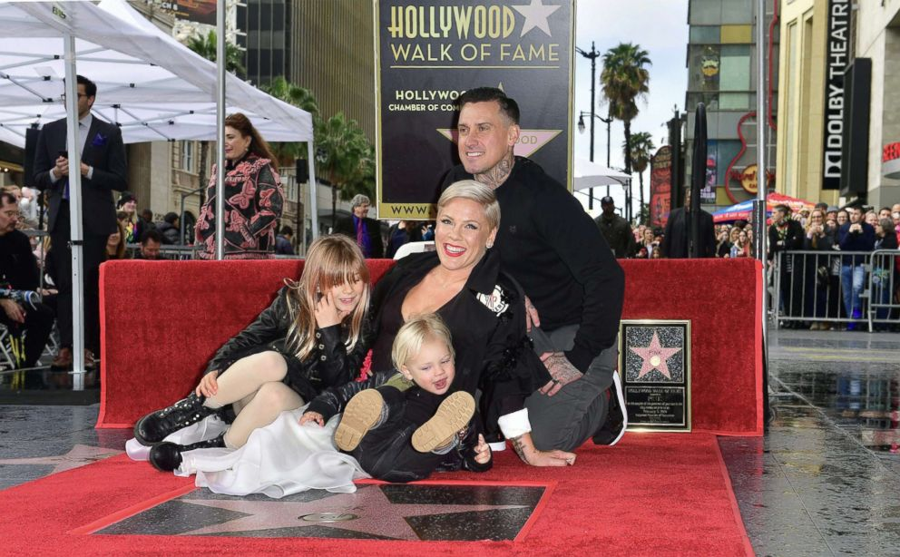 PHOTO: Pink poses with her husband Carey and two children on her Hollywood Walk of Fame Star at a ceremony in Hollywood, Calif.
