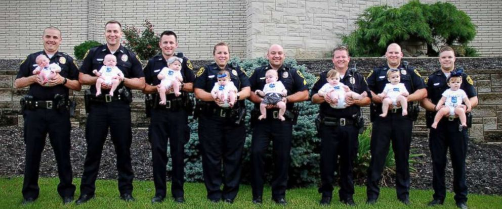 PHOTO: Seven dads and one mom from the Erlanger Police Department in Erlanger, Kentucky, proudly showed off their little ones in a photo after four boys and four girls were born to department staff in less than a year.