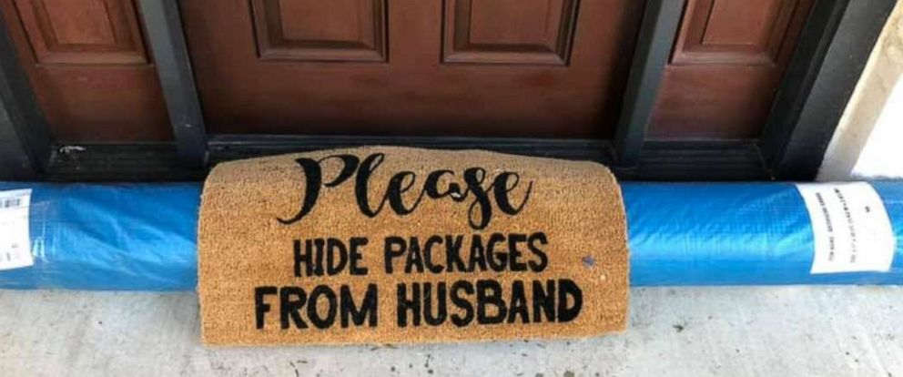 """PHOTO: Ebony Freeman of Texas, shared a photo of her delivery after a UPS driver left her a roll of astro turf under the mat to apparently indicate it was """"hidden."""""""