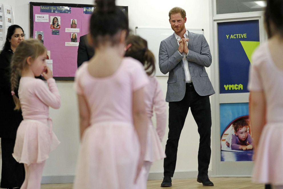 PHOTO:Britains Prince Harry, Duke of Sussex joins children taking part in ballet class for 4 to 6 year olds, while on a visit to YMCA South Ealing in west London on April 3, 2019.