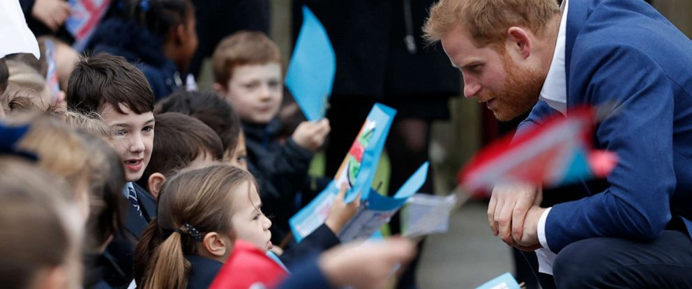 PHOTO: Prince Harry, Duke of Sussex greets school children after planting a tree from the Woodland Trust at St Vincents Catholic Primary School, March 20, 2019, in Acton, England.
