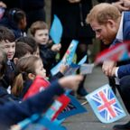 Prince Harry, Duke of Sussex greets school children after planting a tree from the Woodland Trust at St Vincent's Catholic Primary School, March 20, 2019, in Acton, England.