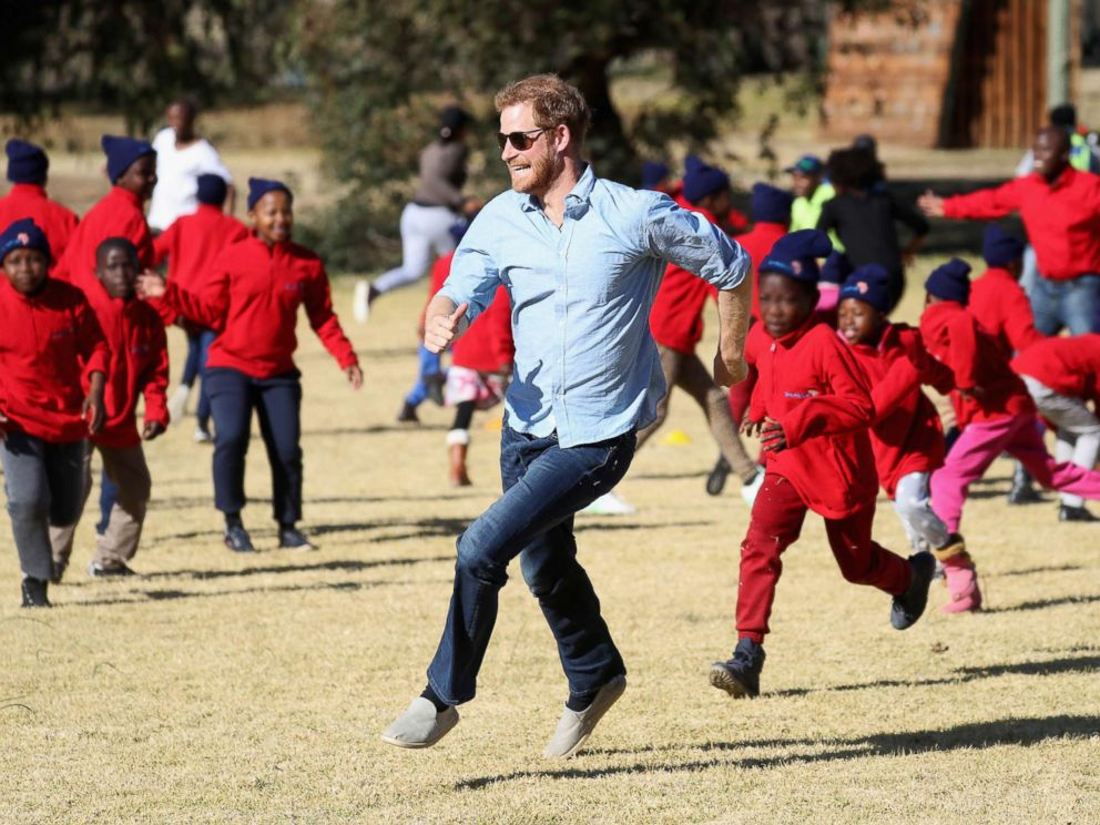 PHOTO: Prince Harry, Duke of Sussex and children run during Winter Camp at Sentebales Mamohato Childrens Centre on June 22, 2018 near Maseru, Lesotho.