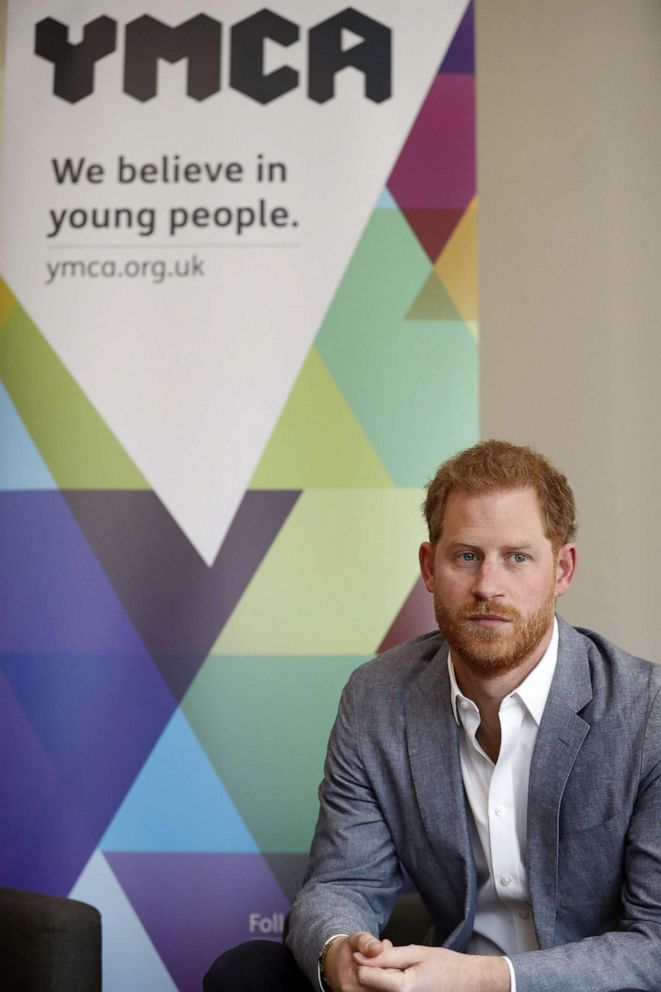 PHOTO:Britains Prince Harry, Duke of Sussex listens to the Youth Ambassadors Mental Health Champions during a visit to YMCA South Ealing in west London on April 3, 2019.