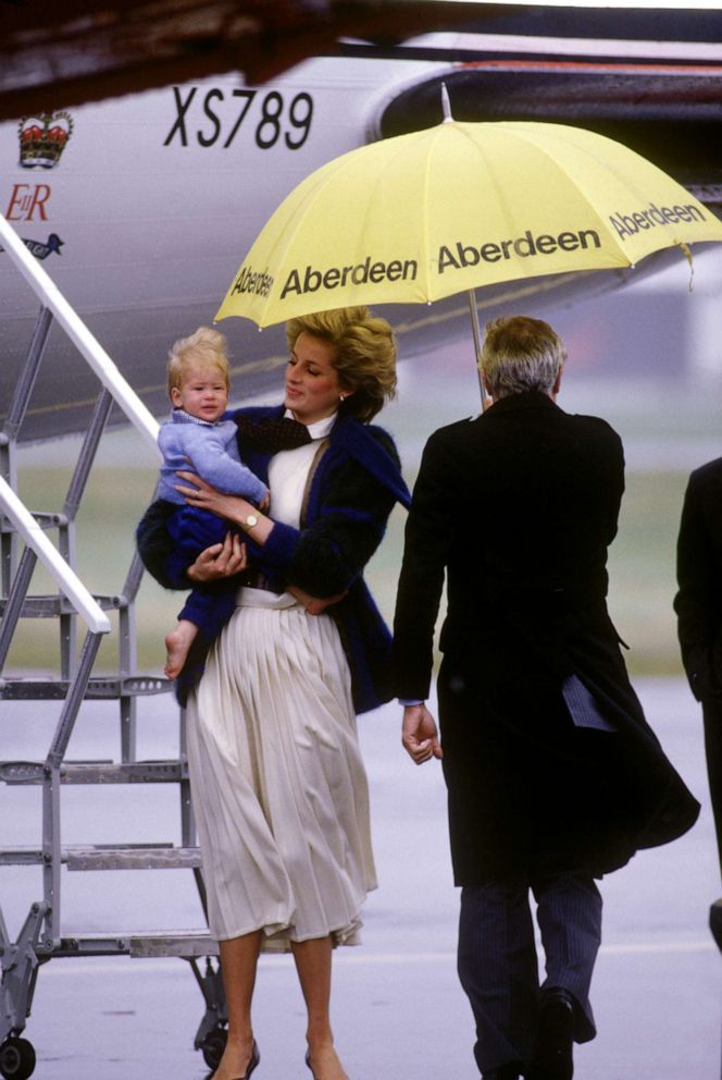 PHOTO: Diana Princess of Wales carries a baby Prince Harry from the Queens Flight aircraft, Sept. 23, 1985, upon arrival at Aberdeen airport in Scotland.