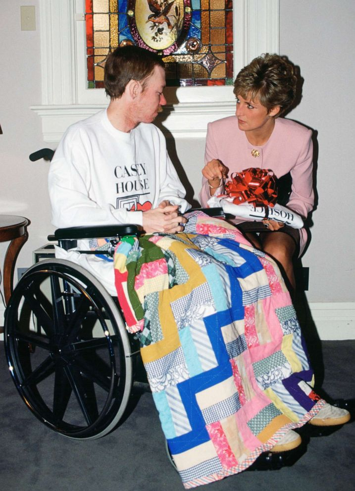 PHOTO: Diana, Princess of Wales sits with one of the residents of Casey House, an AIDS hospice in Toronto, Oct. 25, 1991.