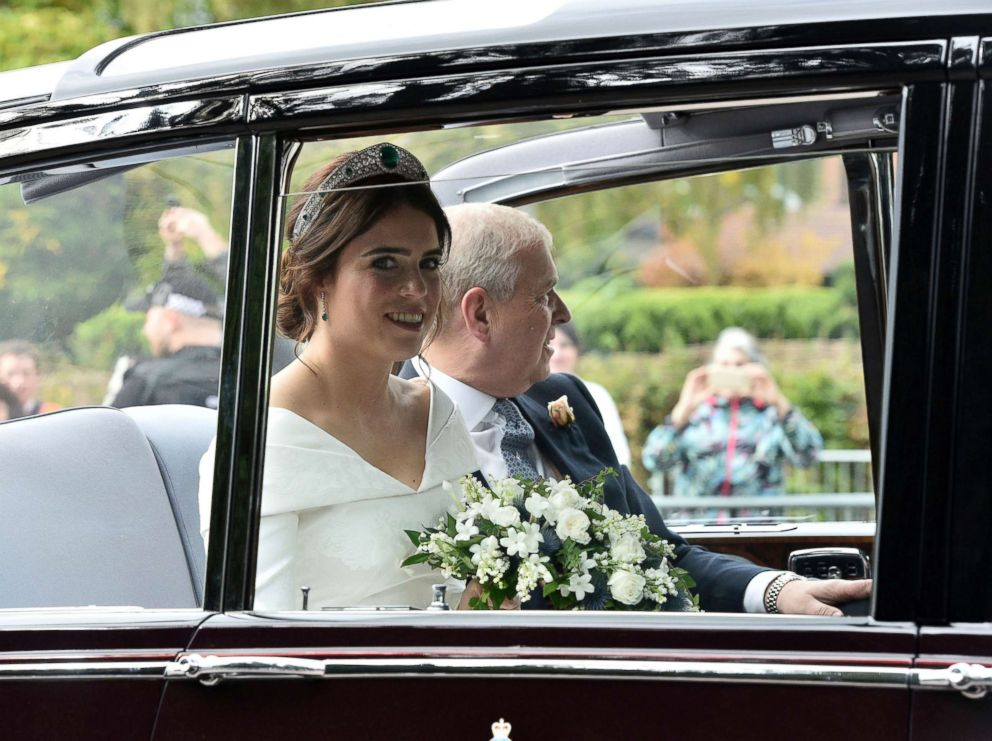 PHOTO: Princess Eugenie of York, left, arrives with her father Prince Andrew, Duke of York for her wedding with Jack Brooksbank in St Georges Chapel, Windsor Castle, England, Oct 12, 2018.