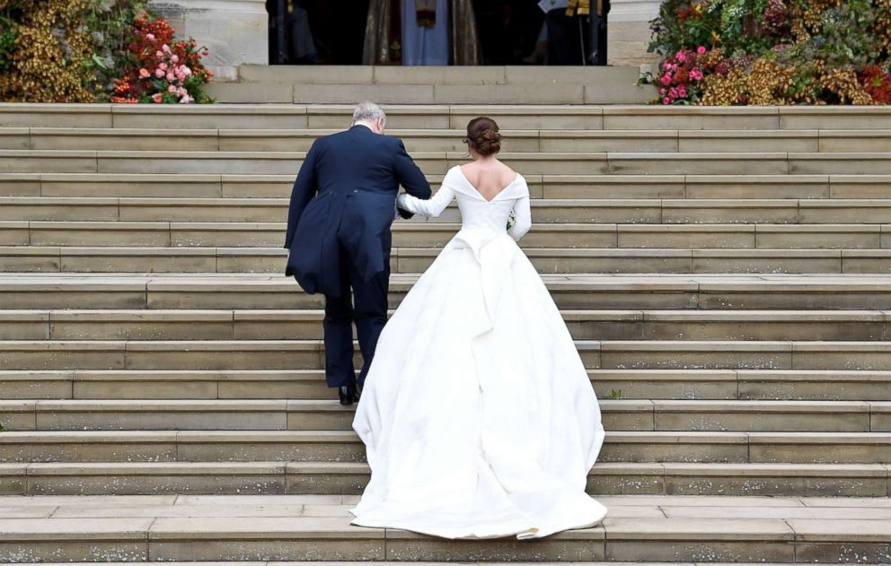 PHOTO: Britains Princess Eugenie arrives accompanied by her father Prince Andrew, Duke of York, at St Georges Chapel for her wedding to Jack Brooksbank in Windsor Castle, Oct. 12, 2018.