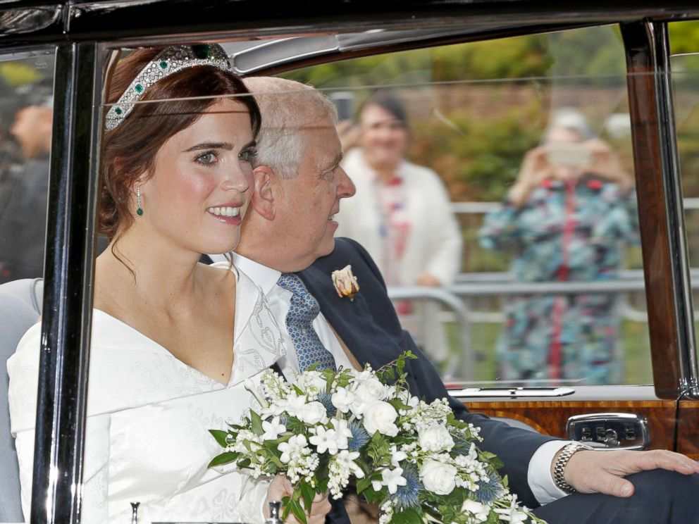 PHOTO: Princess Eugenie is driven towards St Georges Chapel with her father Prince Andrew, Duke of York, for her wedding to Jack Brooksbank at Windsor Castle, Oct. 12, 2018.