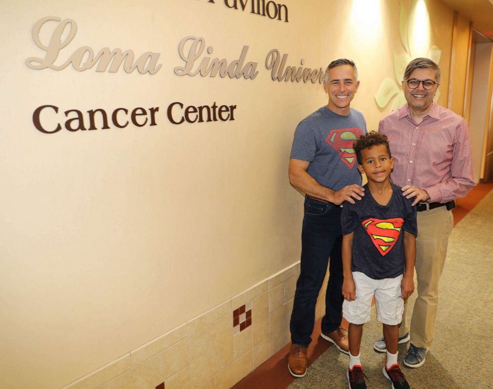PHOTO: Jeff Sipos poses in a recent photo with first grader Jackson Todd, and his oncologist Dr. Muhammad Omair Kamal.