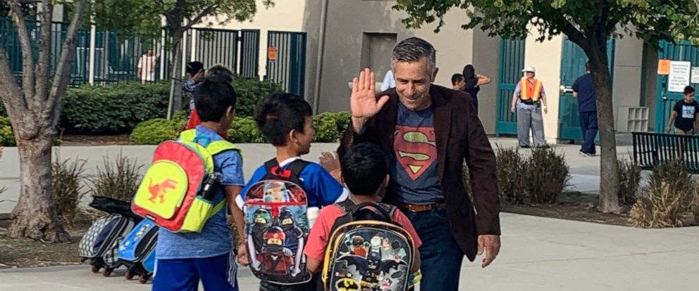 PHOTO: Principal Jeff Sipos kicked off the new school year Aug. 5 by exchanging hugs and high fives with pupils and their families outside John L. Golden Elementary School in Rancho Cucamonga, California.