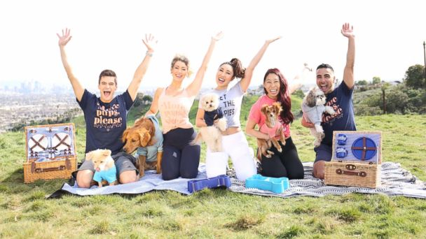 Plank with a puppy! This fitness group is celebrating National Puppy Day in the cutest way