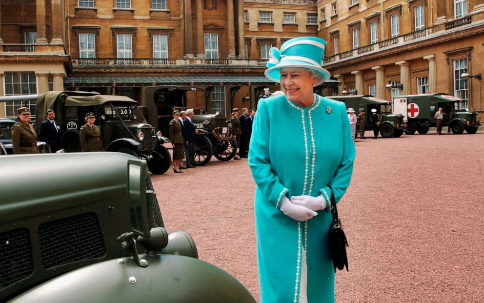 PHOTO: Queen Elizabeth ll looks at vintage vehicles used by the First Aid Nursing Yoemanry during World War II, in which the Queen herself served, in the quadrangle at Buckingham Palace on June 28, 2007 in London, England.