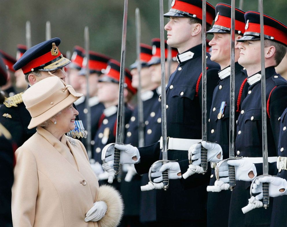 PHOTO: Queen Elizabeth II as proud grandmother smiles at Prince Harry as she inspects soldiers at their passing-out Sovereigns Parade at Sandhurst Military Academy, April 12, 2006, in Surrey, England.