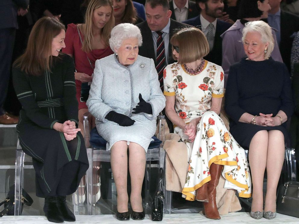 PHOTO: Queen Elizabeth II sits next to Anna Wintour and Caroline Rush (left), and royal dressmaker Angela Kelly at a show during London Fashion Week, on February 20, 2018.