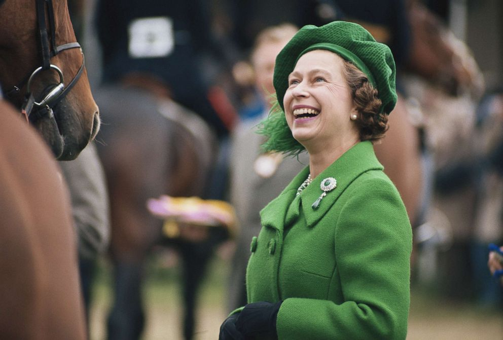 PHOTO: Queen Elizabeth II, wearing a green coat and matching hat, attends the Royal Windsor Horse Show, held at Home Park in Windsor, Berkshire, England, circa 1980.