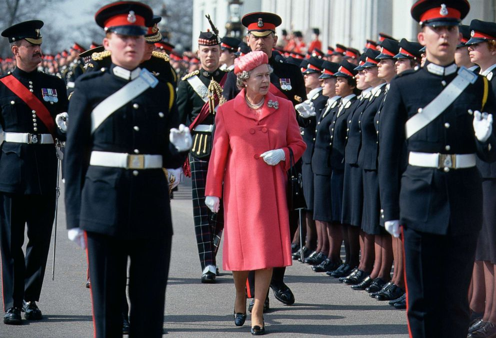 PHOTO: Queen Elizabeth II inspects the troops at the passing out parade at Sandhurst Military Academy in Berkshire, England, in 1985.