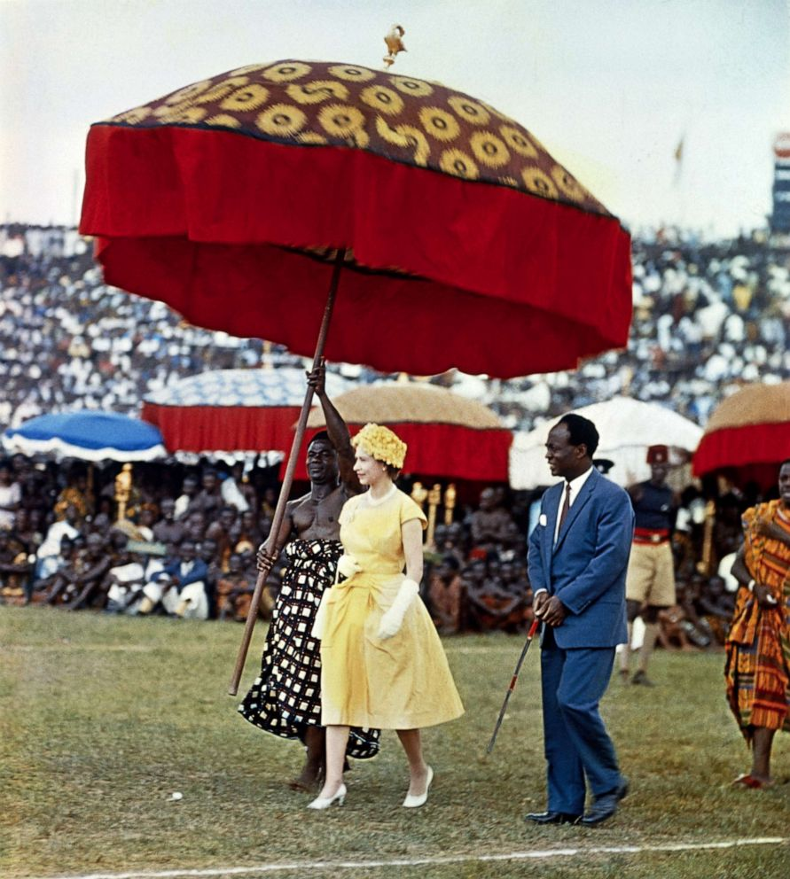 PHOTO: Queen Elizabeth II makes her way underneath a large, colored umbrella, to a dais to watch the Durbar of the Ashanti Chiefs, at Kumasi Sports Stadium in Ghana, Nov. 15, 1960.