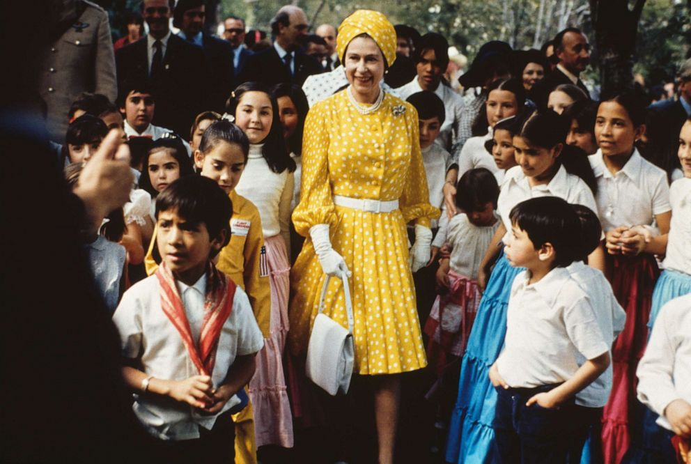 PHOTO: Queen Elizabeth II visits with a group of local children during her state visit to Mexico, March 1, 1975.