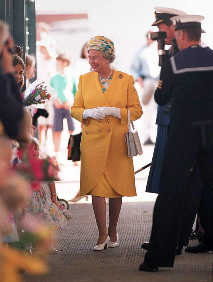 PHOTO: Queen Elizabeth II greets people on her way to board the yacht Britannia for a cruise, Aug. 7, 1996, in Portsmouth, England.