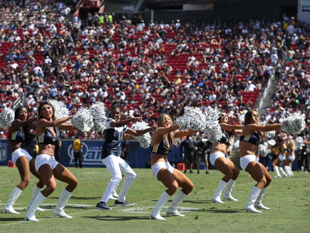 PHOTO: Quinton Peron performs with the Los Angeles Rams cheerleaders during the game between the Los Angeles Rams and the Oakland Raiders at Los Angeles Memorial Coliseum, Aug. 18, 2018, in Los Angeles.