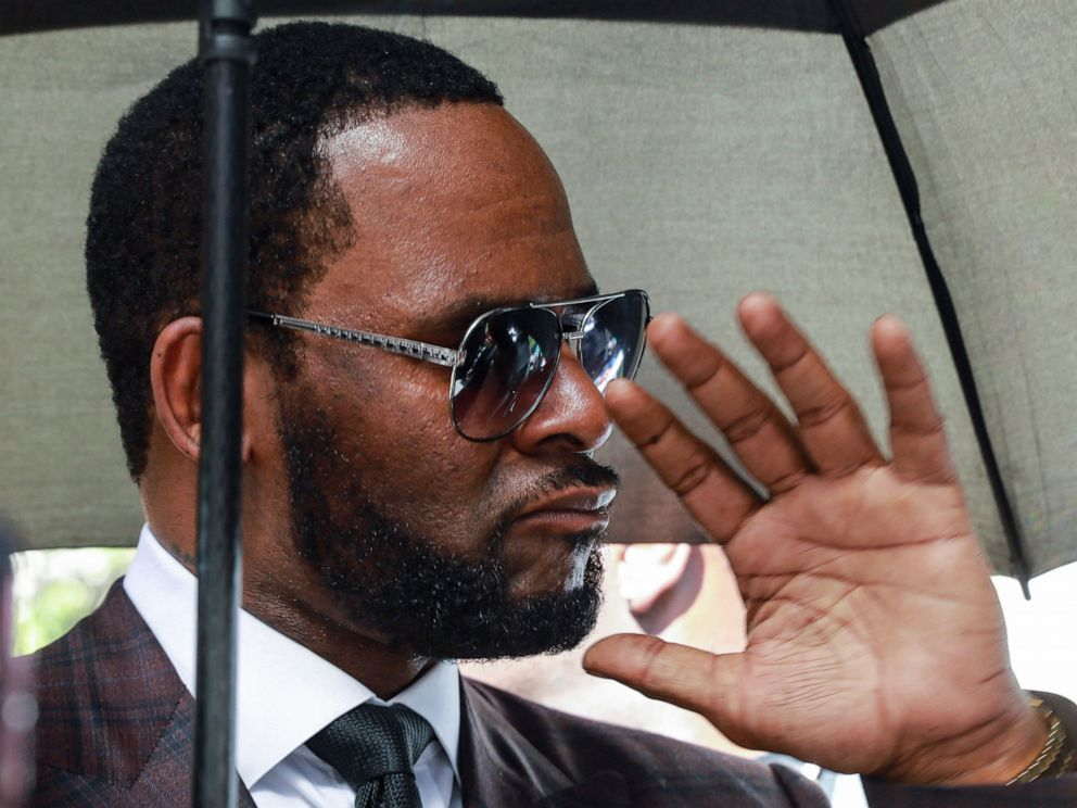 PHOTO: In this June 26, 2019, file photo, Musician R. Kelly departs from the Leighton Criminal Court building after a status hearing in his criminal sexual abuse trial in Chicago.