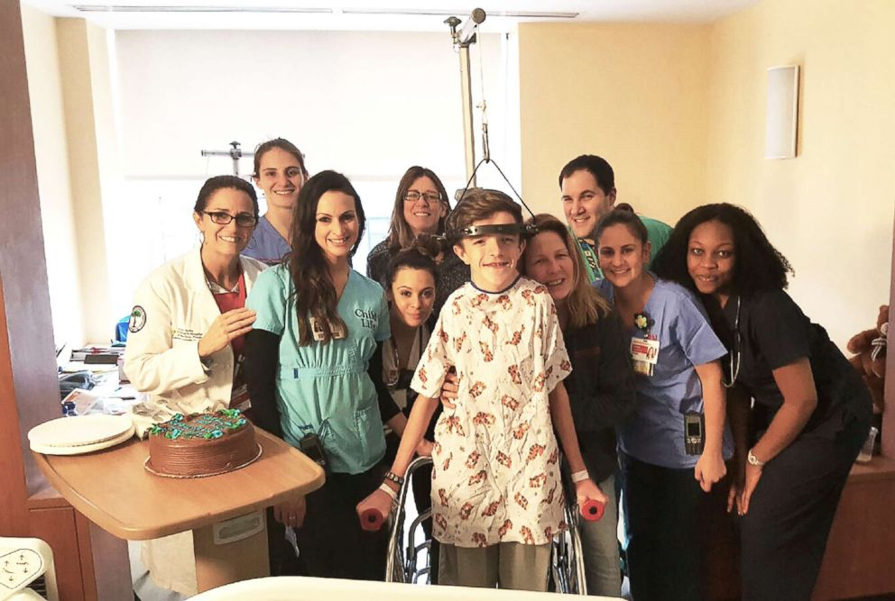 PHOTO: John Sarcona with friends at NewYork-Presbyterian Hospital after being put in Halo Traction.