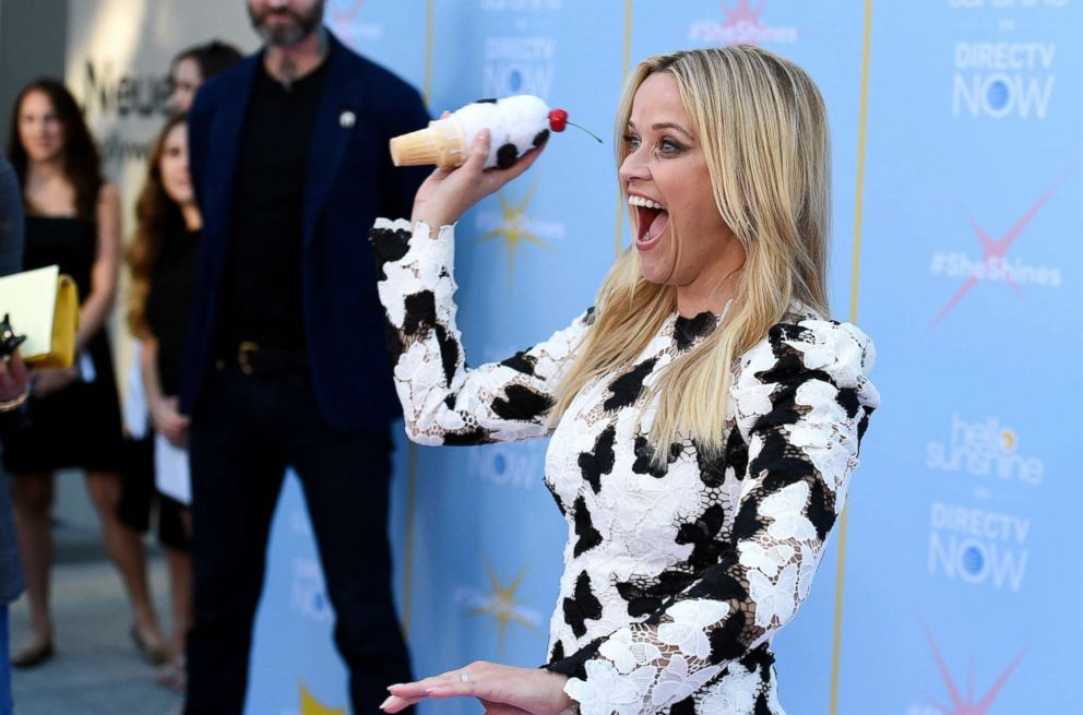 PHOTO: Reese Witherspoon jokingly reenacts the time she threw an ice-cream cone at Meryl Streep at the Hello Sunshine Video on Demand channel launch at NeueHouse Hollywood, Aug. 6, 2018 in Los Angeles.