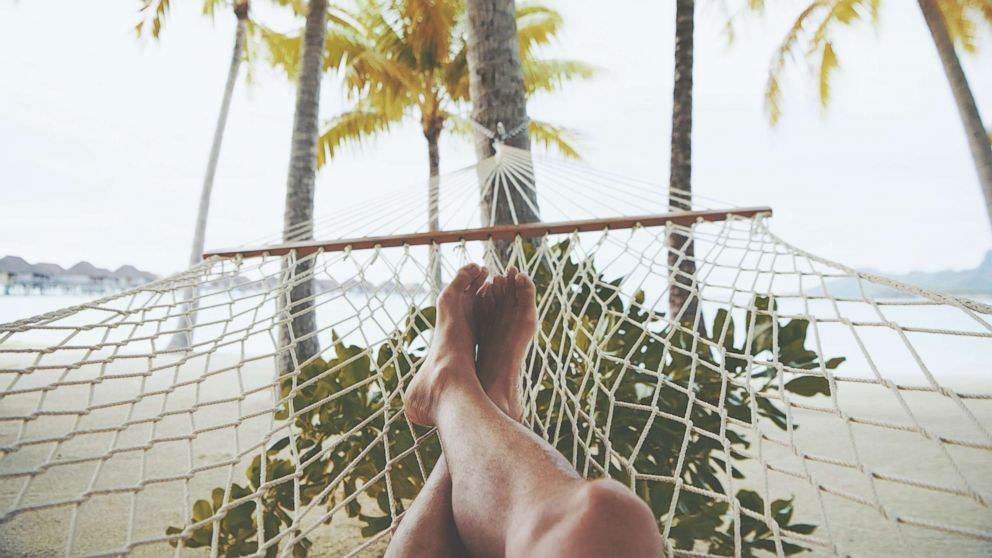 An undated stock photo of a person in a hammock.
