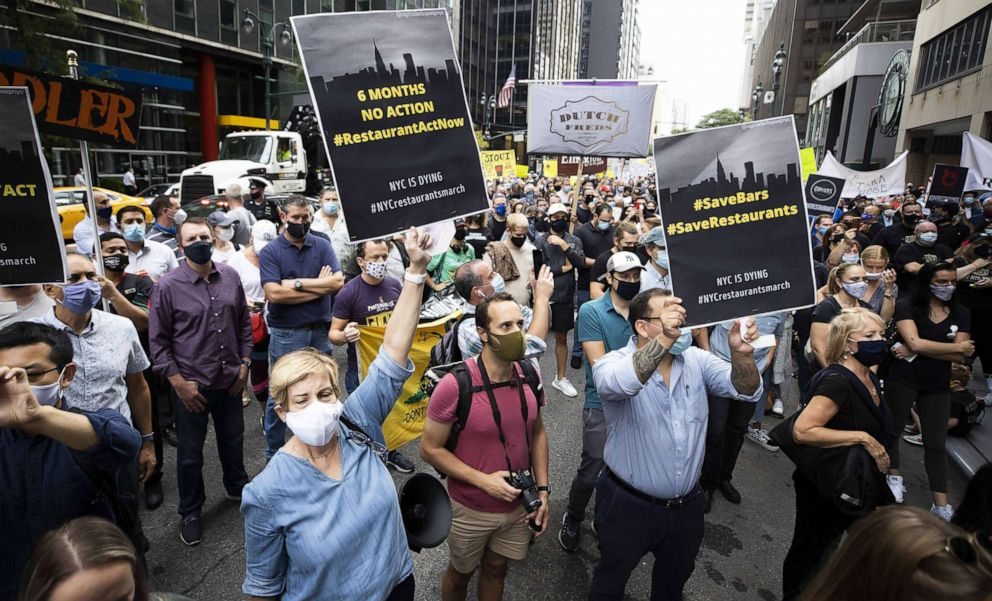 PHOTO: People gather for a protest outside of the offices of New York Governor Andrew Cuomo calling for a loosing of occupancy restrictions for the city's restaurants in New York, Sept. 28, 2020.
