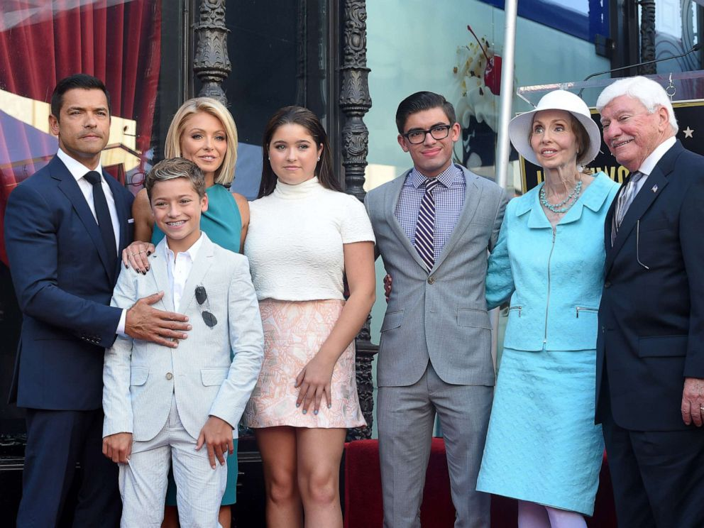 PHOTO: Kelly Ripa, husband Mark Consuelos, daughter Lola Consuelos, sons Michael Consuelos and Joaquin Consuelos, mom Esther Ripa and dad Joseph Ripa attend the ceremony honoring Kelly Ripa with a star on the Hollywood Walk of Fame, Oct. 12, 2015.